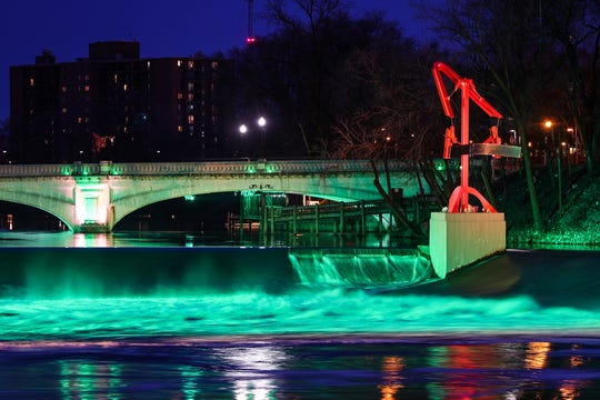 The South Bend River Lights are seen along the St. Joseph River in downtown South Bend on Tuesday, March 12, 2019.