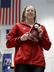 Indiana's Lilly King holds her trophy after winning the 100 breaststroke at the NCAA Women's Swimming & Diving championships, March 17, 2017 in Indianapolis.