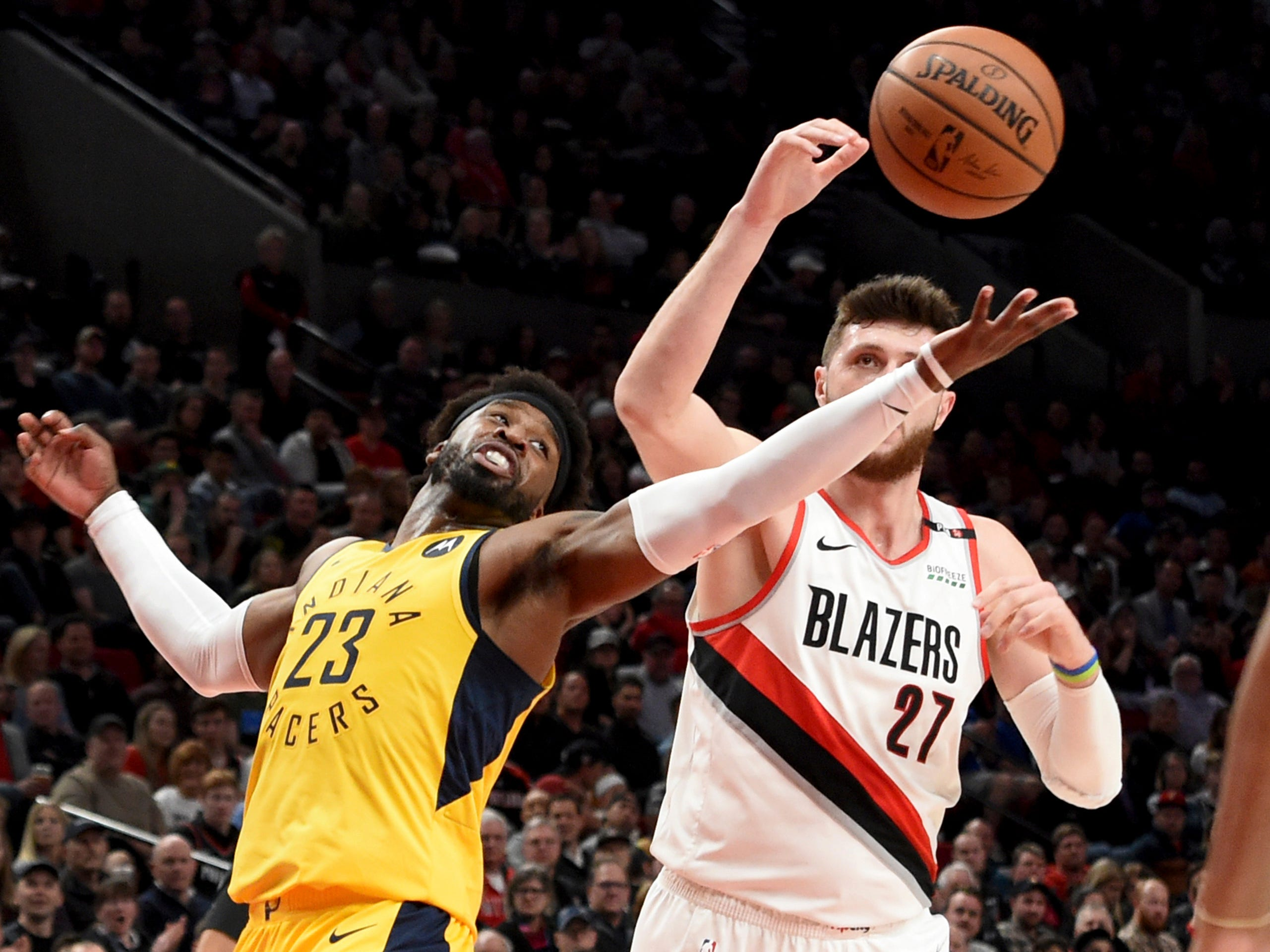 Indiana Pacers guard Wesley Matthews, left, battles for a rebound with Portland Trail Blazers center Jusuf Nurkic, right, during the first half of an NBA basketball game in Portland, Ore., Monday March 18, 2019.
