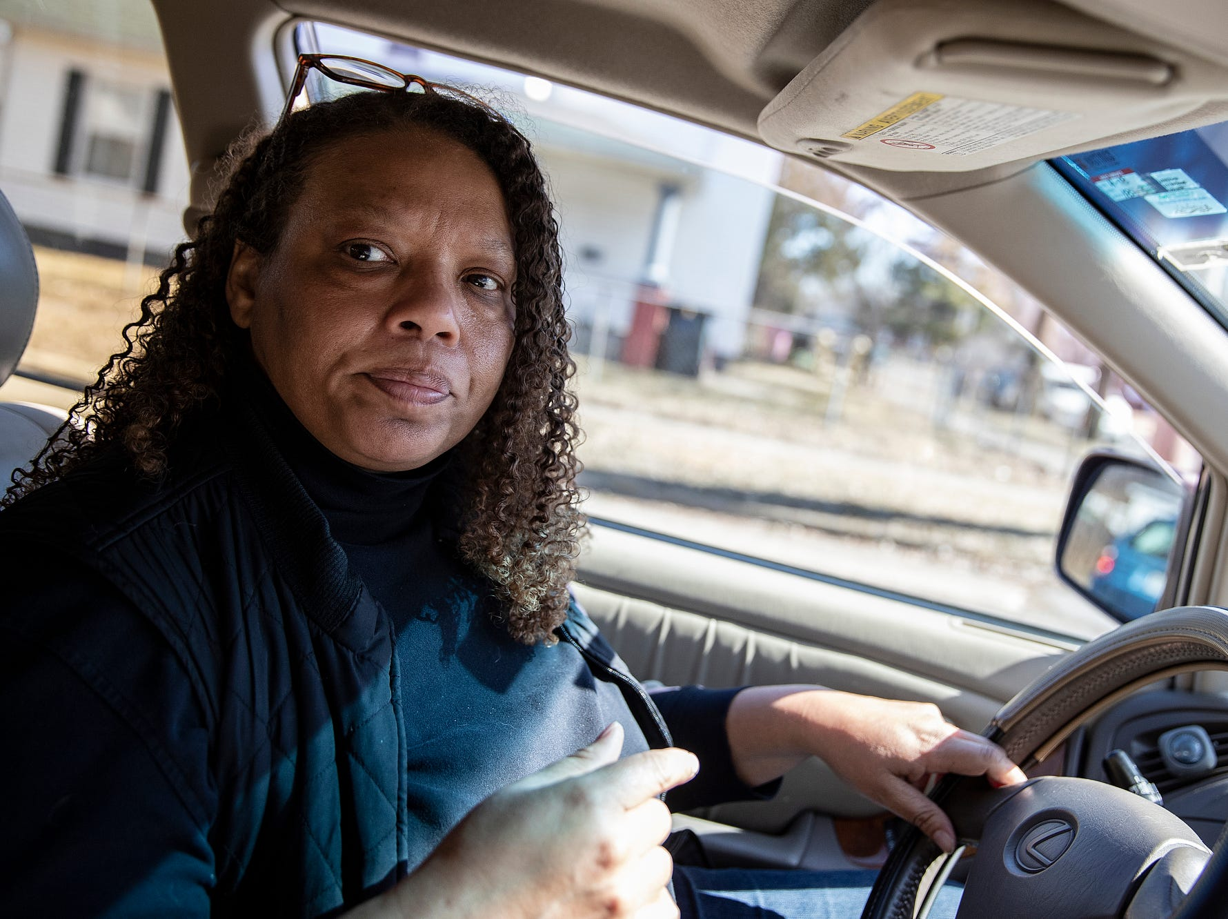 "Regina Williams-Preston, a City Council member who represents a predominantly African American area on the northwest side of South Bend, drives through her neighborhood on Tuesday, March 12, 2019. Williams-Preston is one of many who fear Mayor Pete Buttigieg's policies have lead to gentrificaiton, but gives credit to Buttigieg for his willingness to hear the concerns. ""I think it's really a mark of a true leader to hear that maybe I'm doing something wrong because quite frankly, there were a lot of mistakes made,""  Preston-Williams said of Buttigieg's reaction to the concerns. ""But what happened was he did slow down and he did listen and he did change course. And so many people would dig in their heels and just kind of keep going."""