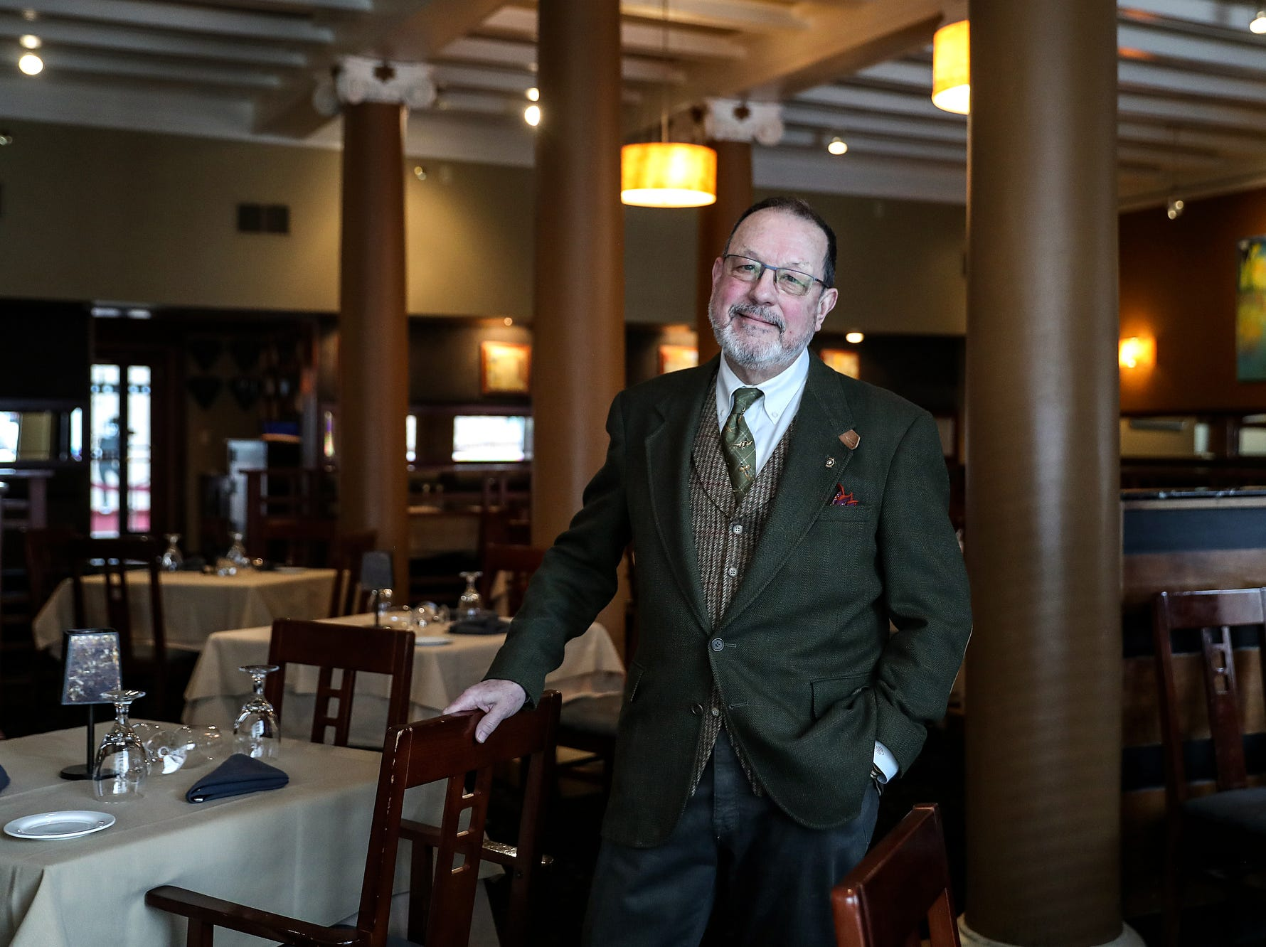 "Mark McDonnell, owner of LaSalle Hospitality Group, poses for a picture at his downtown South Bend restaurant on Wednesday, March 13, 2019. ""It's a heck of a lot better than it was five years ago,"" McDonnell said. ""I think Pete started in the core and made a commitment, 'I'm going to improve downtown.'"""