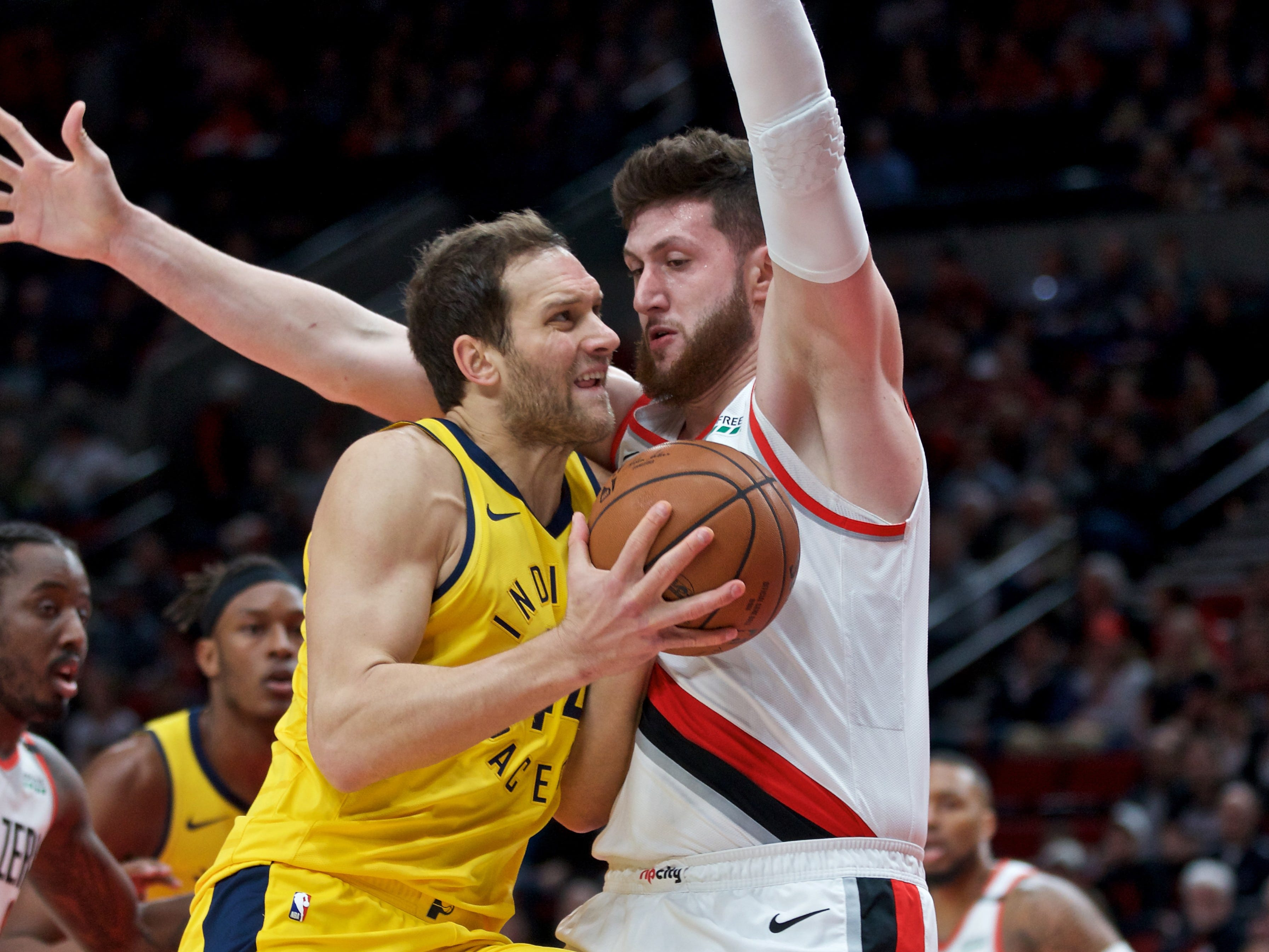 March 18, 2019; Portland, OR, USA; Indiana Pacers forward Bojan Bogdanovic (left) drives to the basket against Portland Trail Blazers center Jusuf Nurkic (right) during the first quarter at the Moda Center.