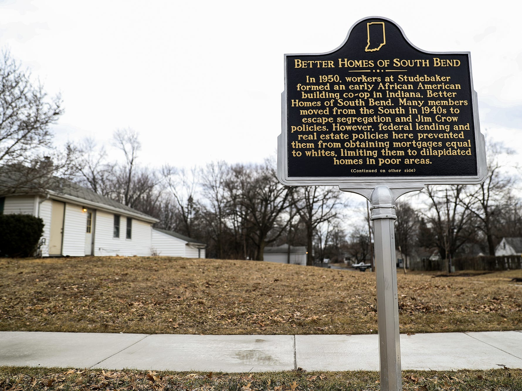 A historic marker on an empty lot recognizes Better Homes of South Bend, the first neighborhood built for African-Americans on the northwest side of South Bend, Ind. seen on Wednesday, March 13, 2019. One of the first homes stood in the empty lot but was sold in the 90s, eventually falling to disrepair, and was taken down as part of the city's initiative to demolish 1,000 vacant, abandoned or dilapidated houses in 1,000 days.