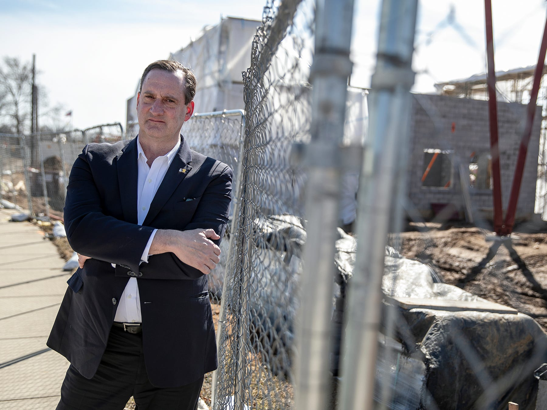 "Tim Scott, South Bend City Council President and a member of the Mayor's Task Force for Vacant and Abandoned Houses, poses for a portrait near construction at Howard Park in downtown South Bend, Ind. on Tuesday, March 12, 2019. Scott was involved in the city's demolition of 1,000 houses in 1,000 days, a project that some say encouraged gentrification and disadvantaged residents. Scott says that many houses had become a safety concern and no one lost the homes in which they were living.Ê""The whole idea was trying to right size the city and try to understand really what our housing needs are and trying to eliminateÊsome of the unsafe low-quality housing that was here and kind of start anew,"" Scott said."