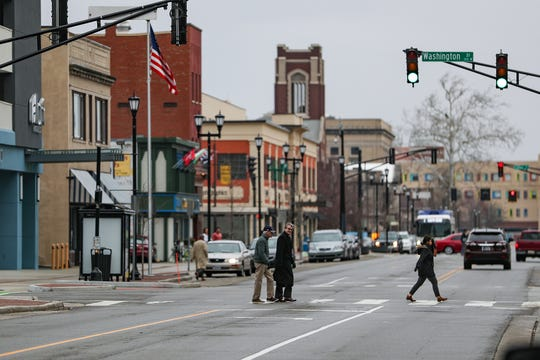 The intersection of Main and Washington is seen in downtown South Bend, Ind. on Wednesday, March 13, 2019. Traffic was converted from one-way to two-way on both streets, as part of Mayor Pete Buttigieg's downtown infrastructure plan.