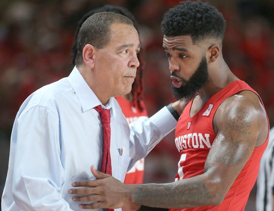 Houston Cougars head coach Kelvin Sampson talks with guard Galen Robinson Jr. (25) while playing against  the UCF Knights in the second half at Fertitta Center.