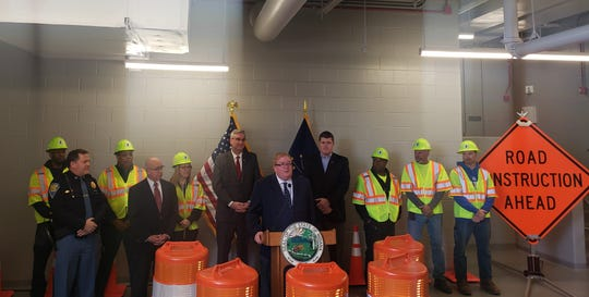 INDOT deputy commissioner of construction Roland Fegan is joined by Gov. Eric Holcomb and INDOT commissioner Joe McGuinness to announce the kick off of the 2019 Next Level Roads construction season.