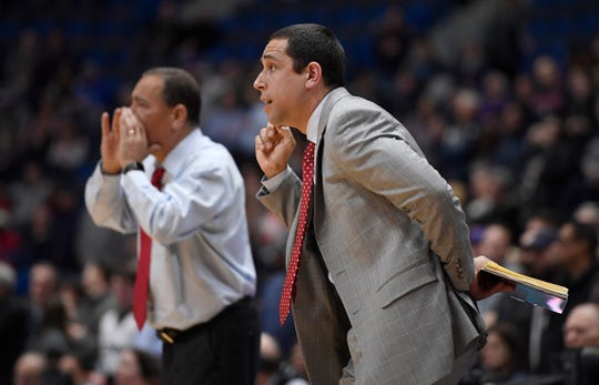 Houston assistant coach Kellen Sampson, right, with father head coach Kelvin Sampson during the first half of an NCAA college basketball game against Connecticut, Thursday, Feb. 14, 2019, in Hartford, Conn. (AP Photo/Jessica Hill)