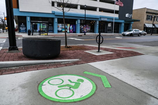 "Bike-friendly paths and roads are the result of an infrastructure initiative by Mayor Pete Buttigieg in downtown South Bend, Ind. seen on Wednesday, March 13, 2019. Part of Mayor Pete Buttigieg's downtown infrastructure plan was to make ""smarter"" streets, by converting thoroughfare Michigan Street and Martin Luther King Jr. Boulevard into two-way roads. The project also added landscaped medians, bike paths, sidewalks and roundabouts to those streets and others downtown."