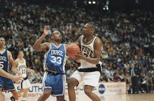 Duke's Grant Hill (33) puts the stop on Purdue's Glenn Robinson (13) during first half NCAA Southeast Regional final action in Knoxville, Tenn., on March 26, 1994.