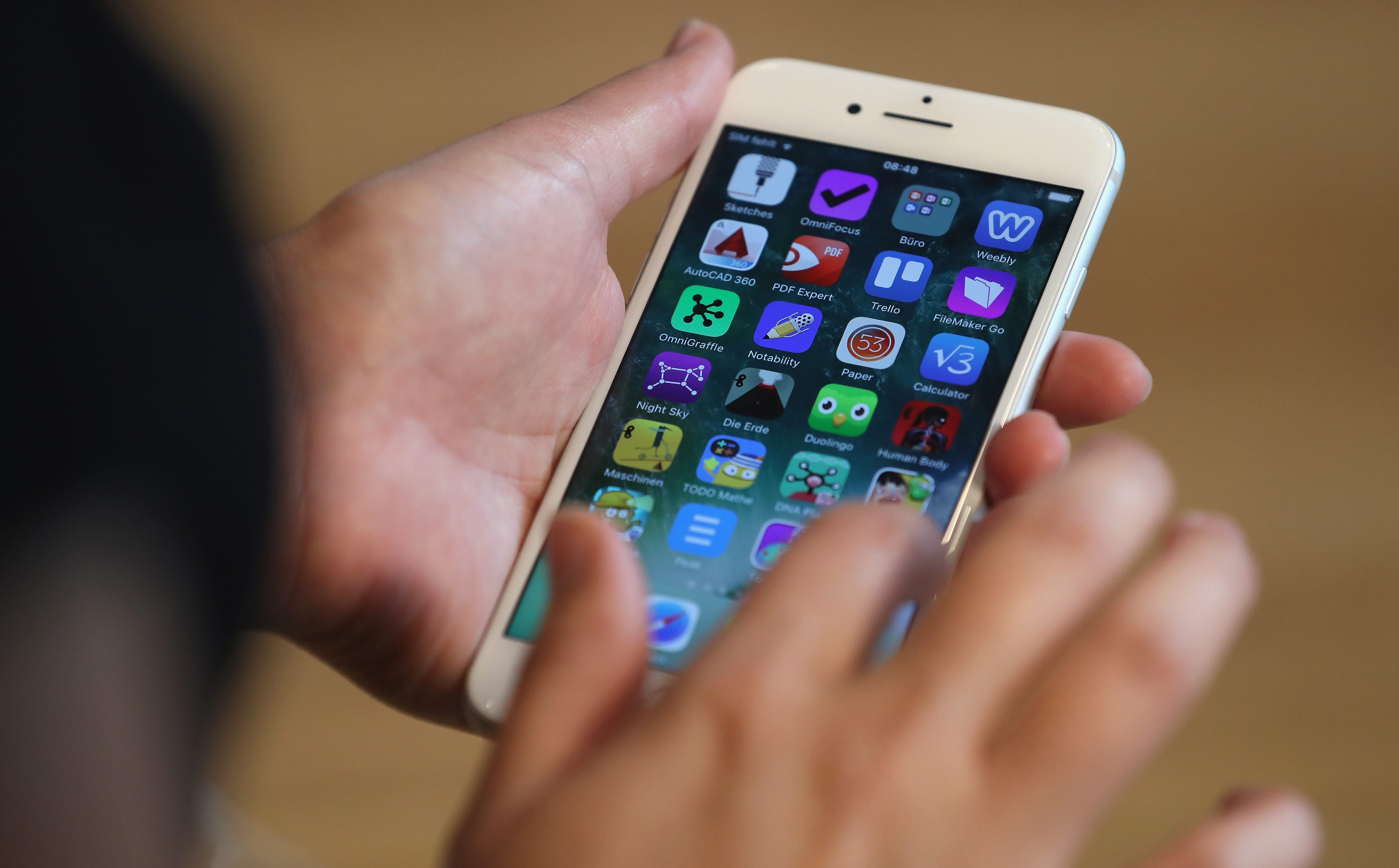 A visitor tries out an Apple iPhone 7 at an Apple store on Sept. 16, 2016, in Berlin, Germany.