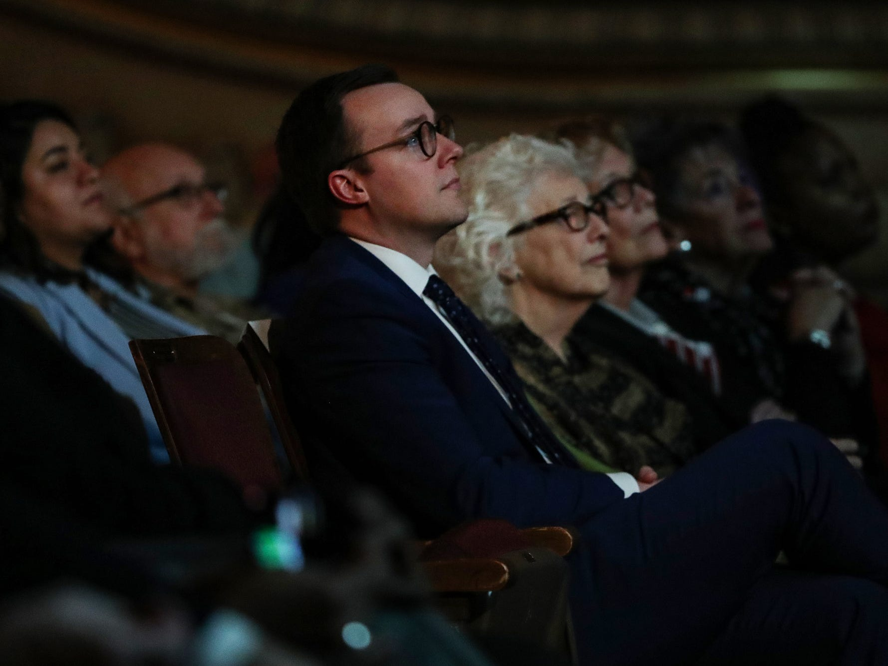 South Bend Mayor Pete Buttigieg's husband Chasten and other family members listen as Buttigieg delivers his final State of the City address in South Bend, Ind. on Tuesday, March 12, 2019.