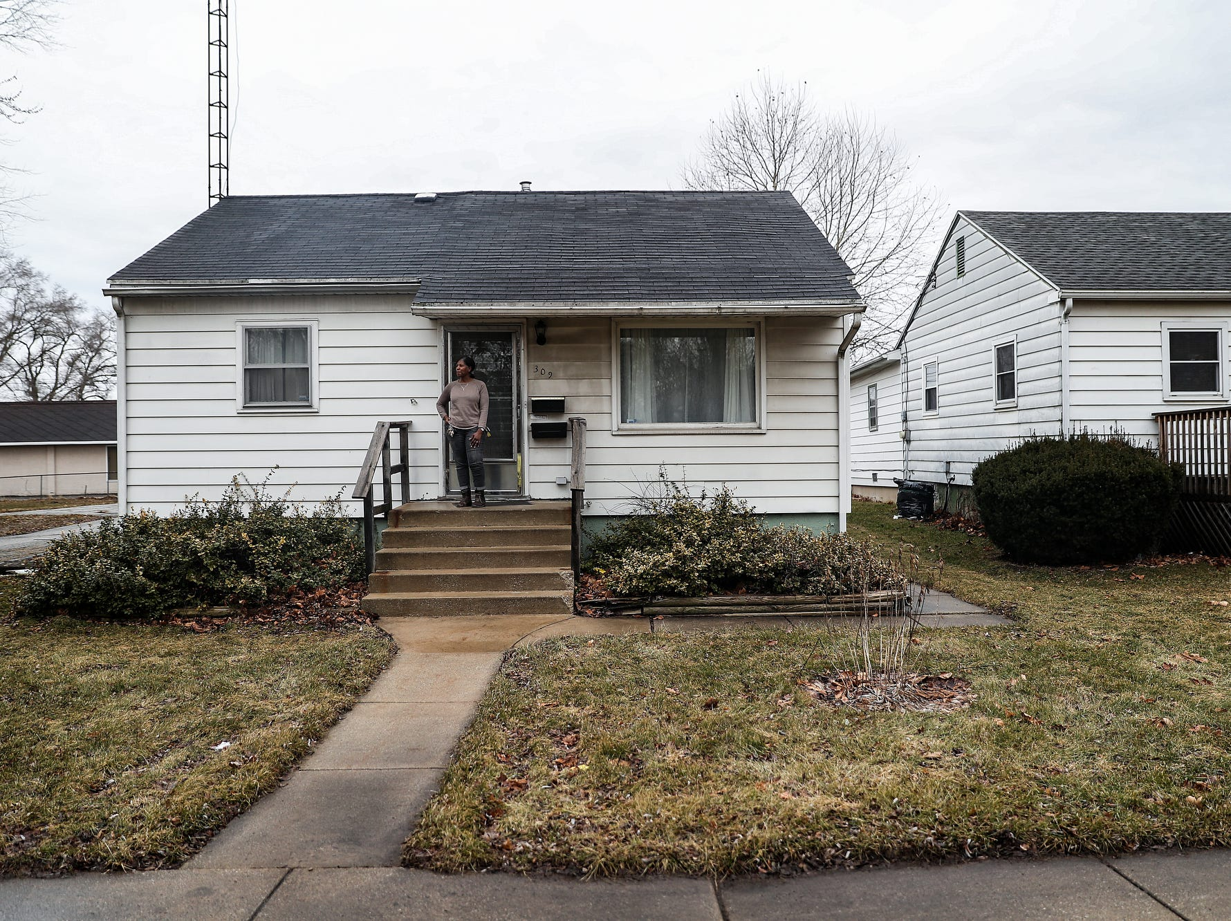 "Stacey Odom, a fourth-generation resident of west-side South Bend neighborhood LaSalle Park, poses for a picture on Wednesday, March 13, 2019. When Odom asked Mayor Pete Buttigieg for $300,000 for a grant program to help community members repair their homes, Buttigieg countered with $650,000, which became the Home Repair Pilot Program. ""ThatÕs the kind of person you want in office,"" she said. ""Someone who is looking at your best interests. And if theyÕre not, if you go to them and tell them what your interests are, then they will take your concerns and make them their concerns."""