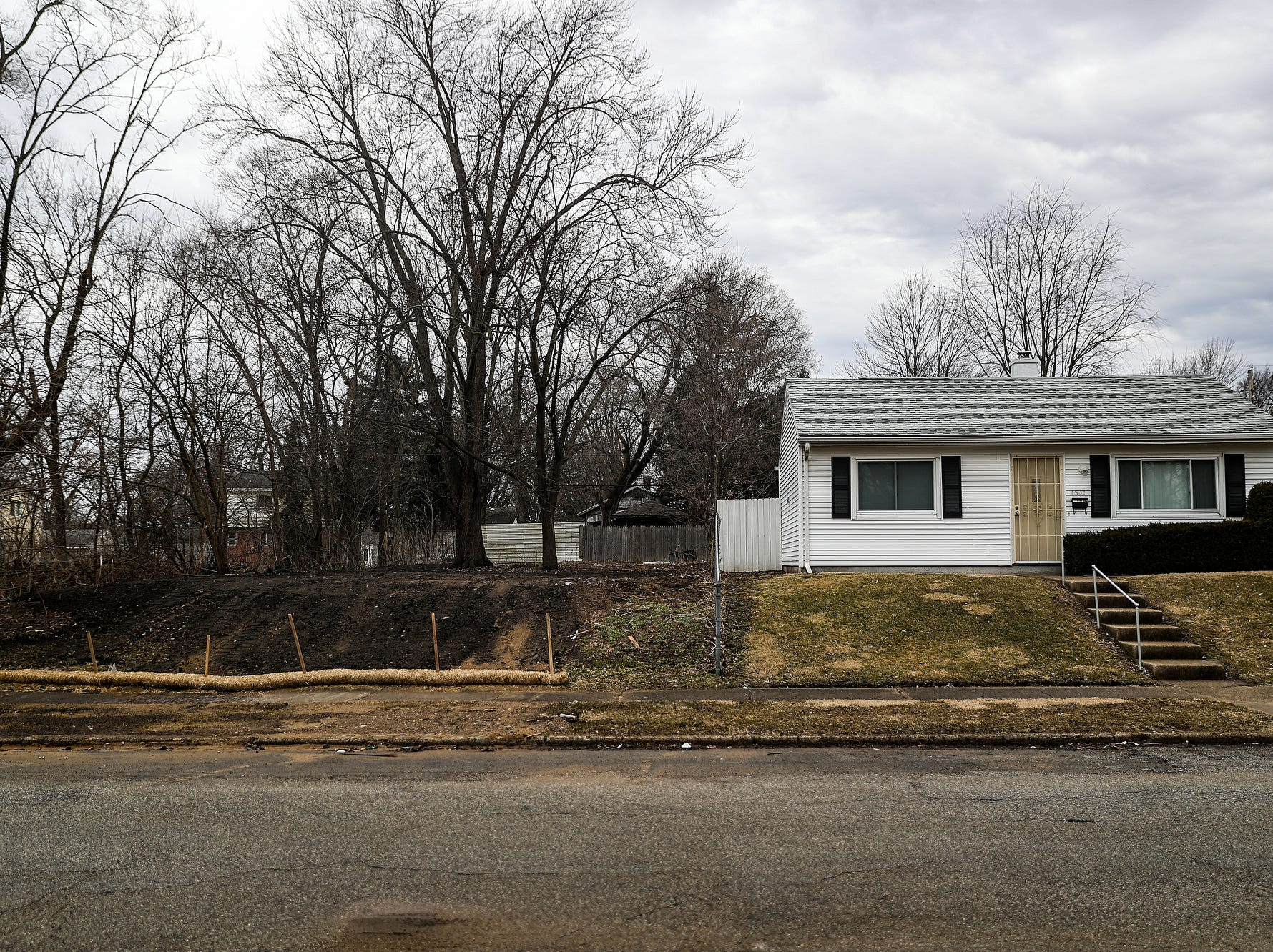An empty lot is seen in Better Homes of South Bend, the first neighborhood built for African-Americans in South Bend, Ind. in the 1950s, seen on Wednesday, March 13, 2019. Some houses in the area were taken down as part of the city's initiative to demolish 1,000 vacant, abandoned or dilapidated houses in 1,000 days.