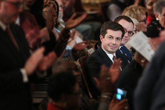 South Bend Mayor Pete Buttigieg watches as city council members are recognized before his annual State of the City address in South Bend on March 12, 2019.