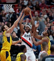 March 18, 2019; Portland, OR, USA; Portland Trail Blazers forward Maurice Harkless (4) shoots over Indiana Pacers forward Bojan Bogdanovic (44) and center Myles Turner (33) during the third quarter at the Moda Center. Mandatory Credit: Craig Mitchelldyer-USA TODAY Sports
