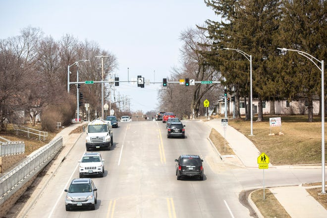 Traffic flows in a single lanes with a dedicated center turn lane on Tuesday afternoon, March 19, 2019, along 1st Avenue past Mall Drive towards Bradford Drive near South East Junior High in Iowa City, Iowa.