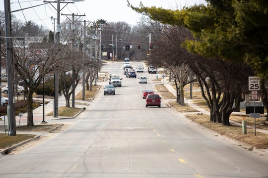 Traffic flows in a single lanes with a dedicated center turn lane on Tuesday afternoon, March 19, 2019, along Muscatine Avenue  in Iowa City, Iowa.