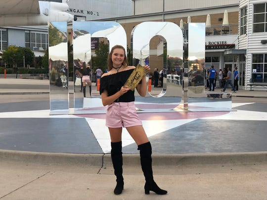 Abbie Callahan holds her gold ticket to Hollywood after auditioning in Denver, Colorado.