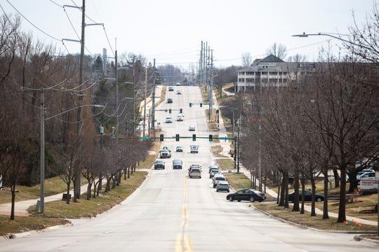 Traffic flows on Tuesday afternoon, March 19, 2019, along Mormon Trek Blvd. in Iowa City, Iowa.