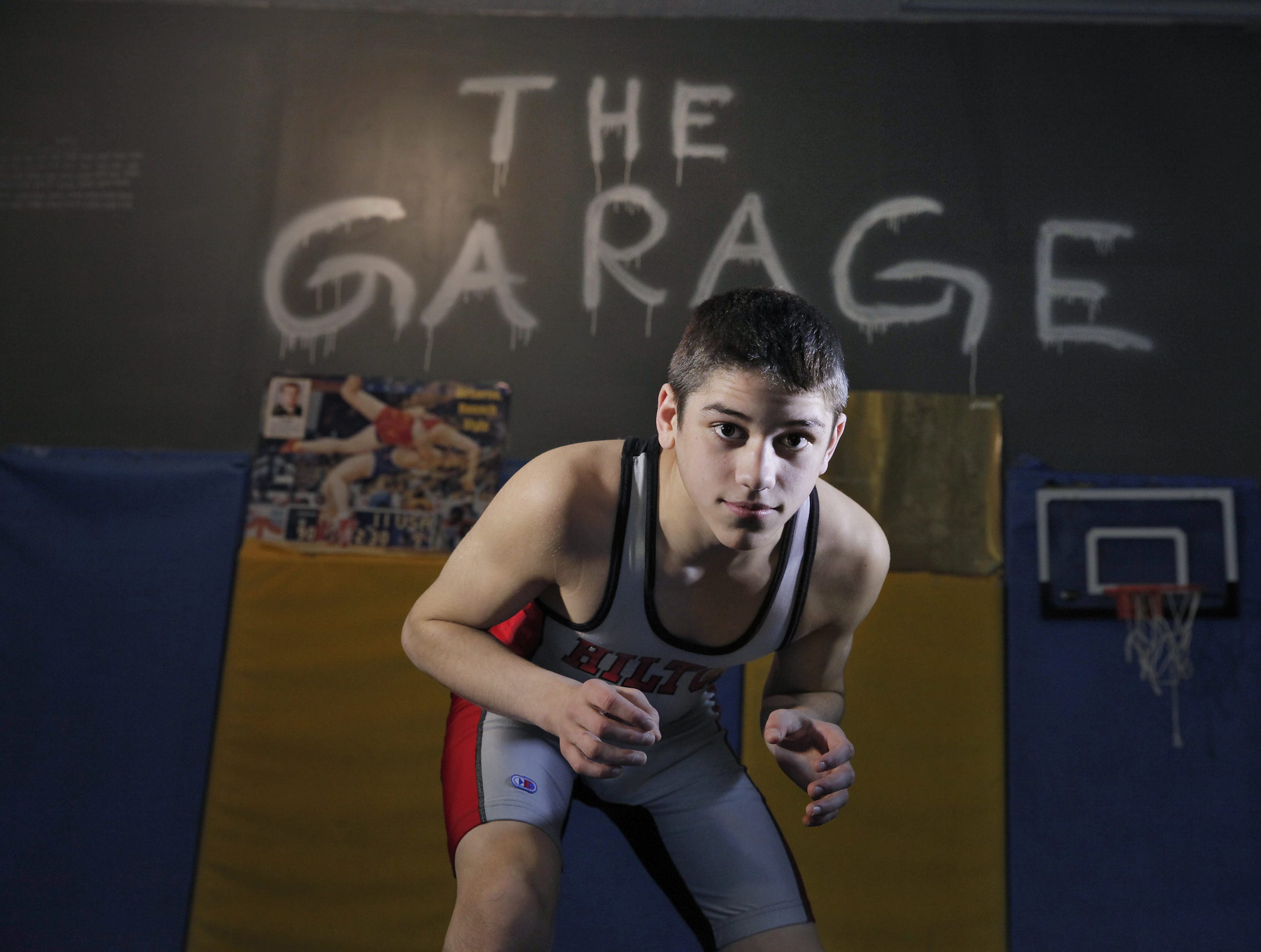 Eighth-grader Yianni Diakomihalis of Hilton hones his skills in 'The Garage,' a training facility at his family's home.
