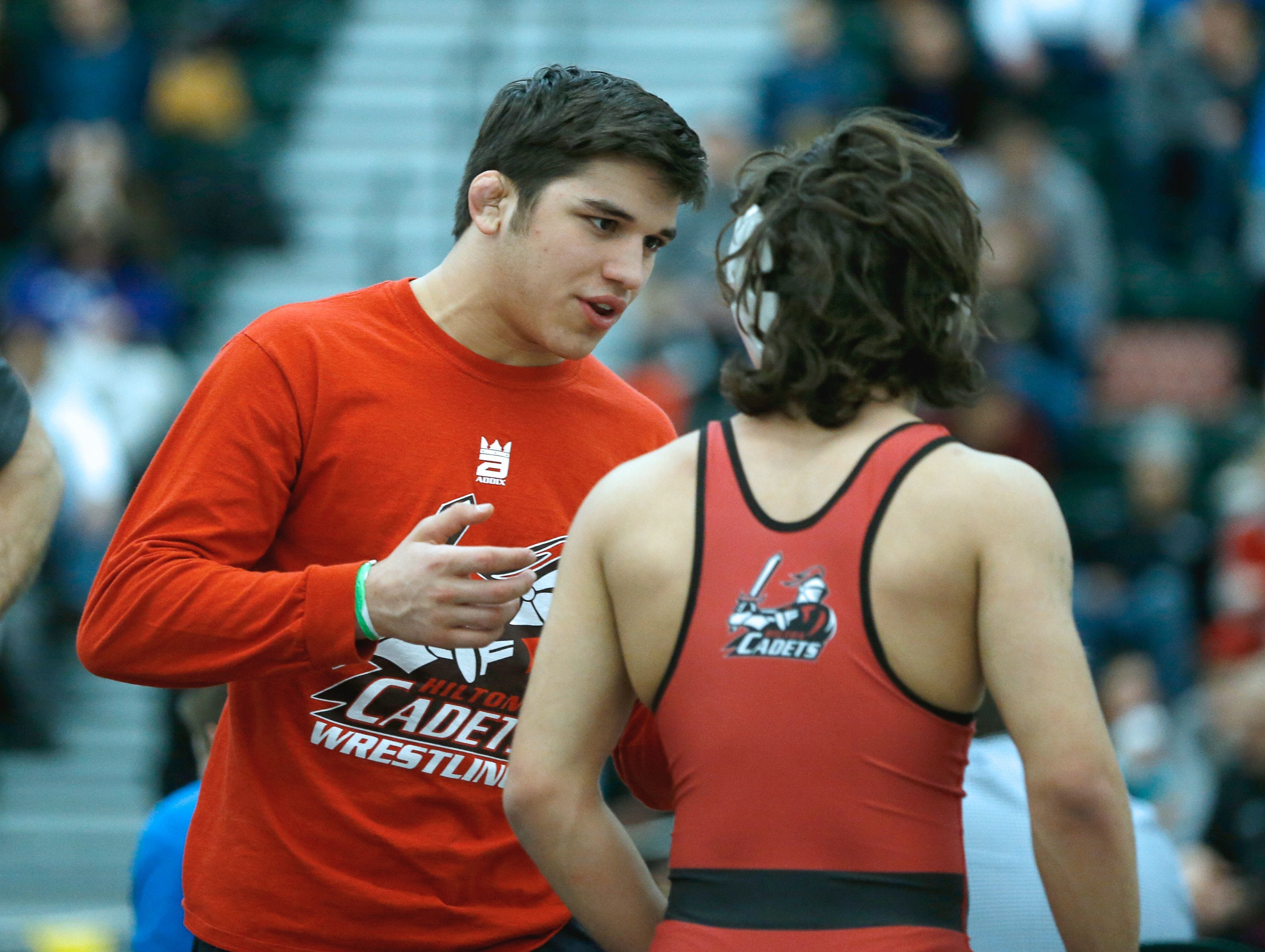 Unable to be on the mats after injuries ended his season, multiple-state champion Yianni Diakomihalis, left, shared his knowledge with brother, Greg, and Hilton teammates in 2017.
