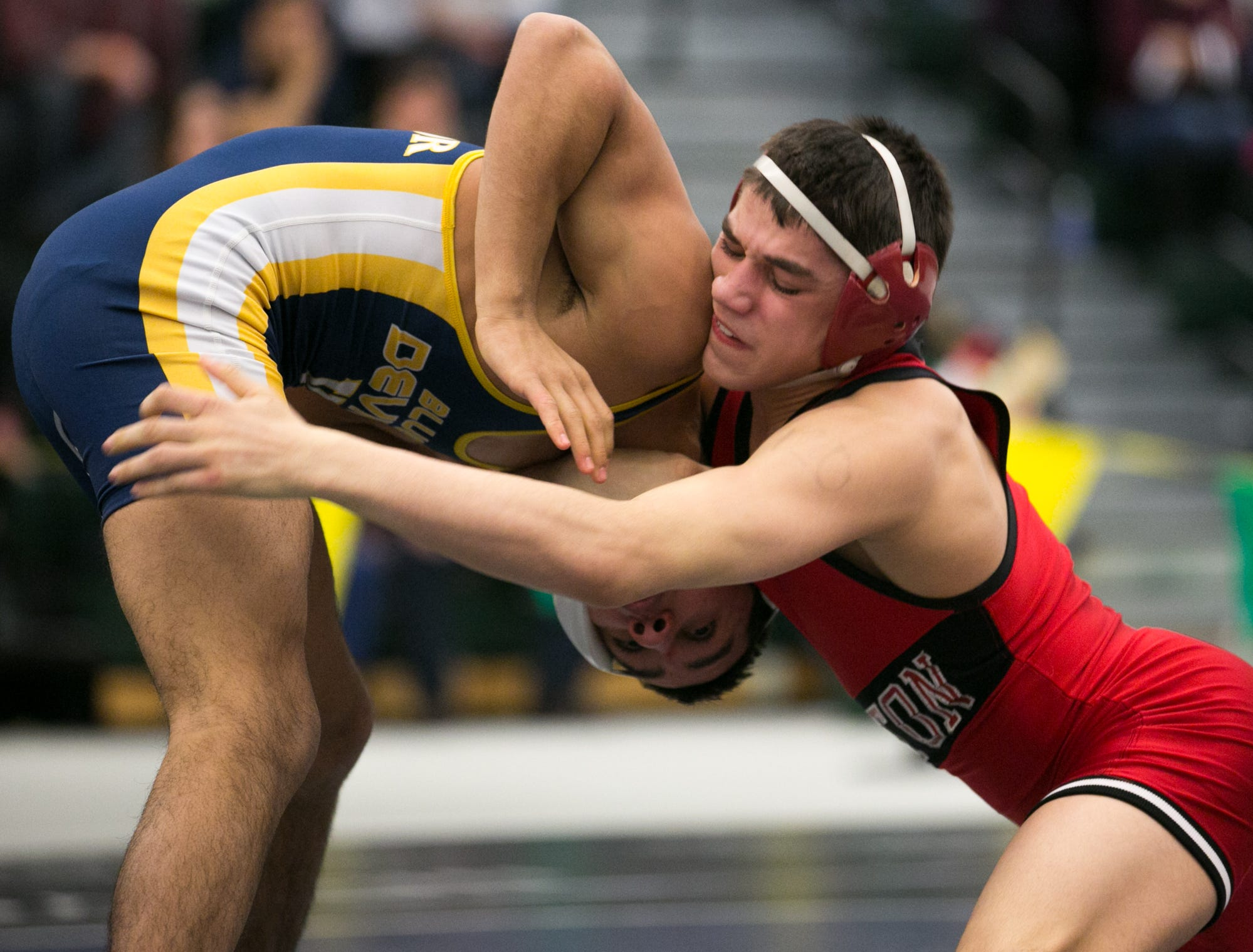Yianni Diakomihalis of Hilton, right, competes with Mike Venosa of Victor in the championship match for the 120-pound weight class at the state qualifying wrestling meet at the College and Brockport on Saturday, February 14, 2015.