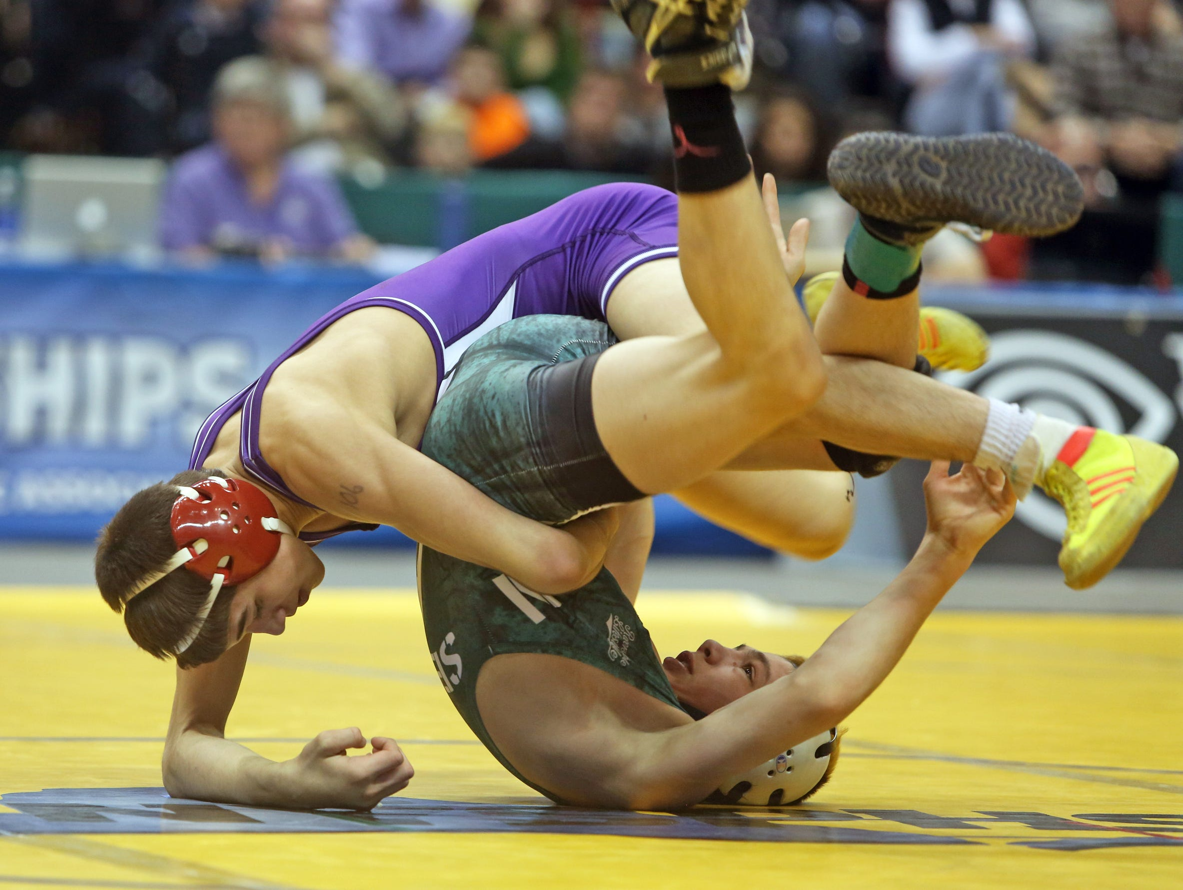 Yianni Diakomihalis of Hilton, left, defeated Vinny Vespa of Monroe Woodbury to win the Div. I 106 pound championship at the New York State Wrestling Championships at the Times Union Center in Albany March 1, 2014.