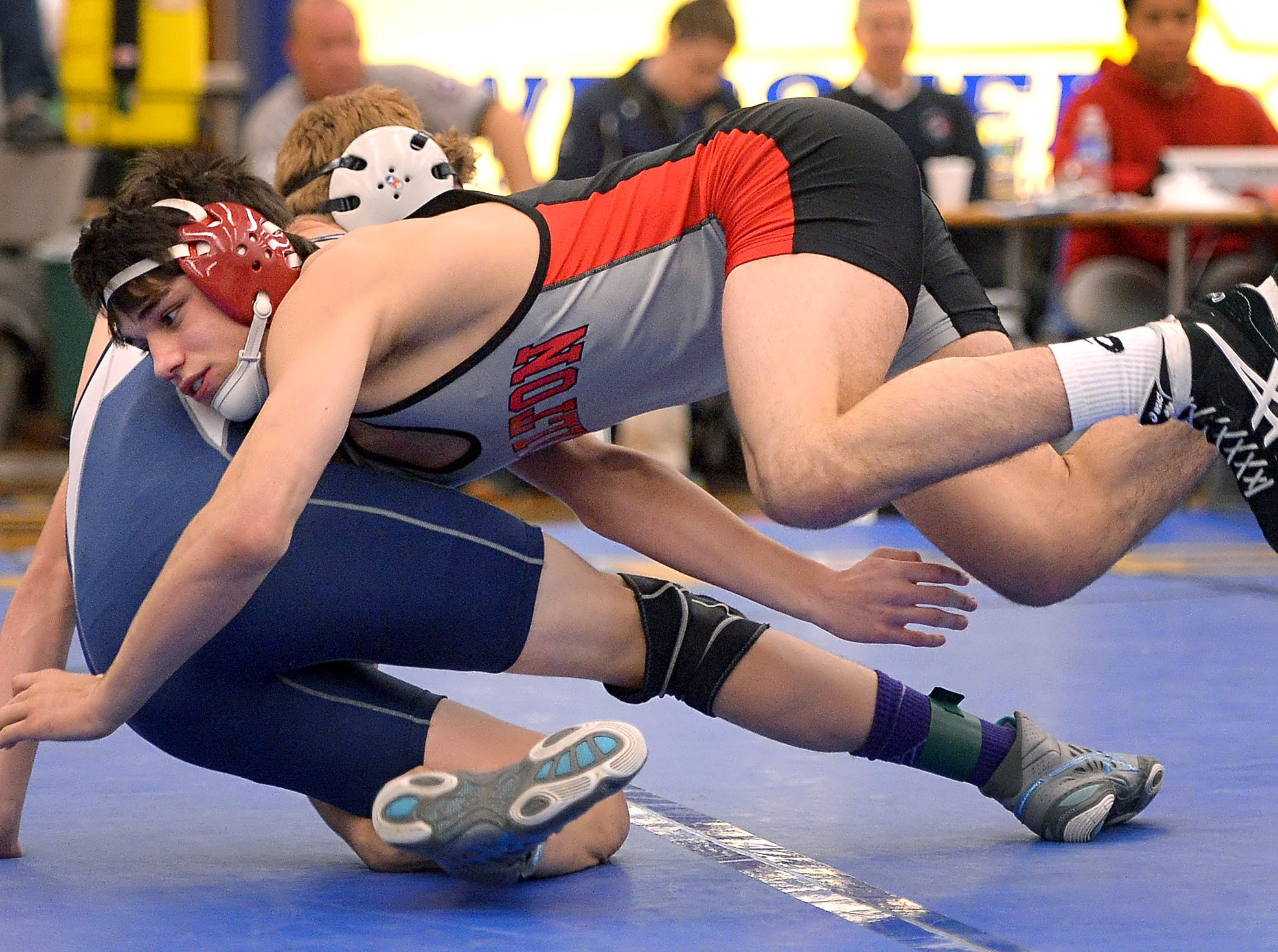 Hilton's Yianni Diakomihalis, front, pinned Gates-Chili's Derek St. James in the second period of the finals of the 138 lb. weight class during the Monroe County League Wrestling Championships held at Webster Schroeder High School on Saturday, December 19, 2015. The win gives Diakomihalis 200 for his career.