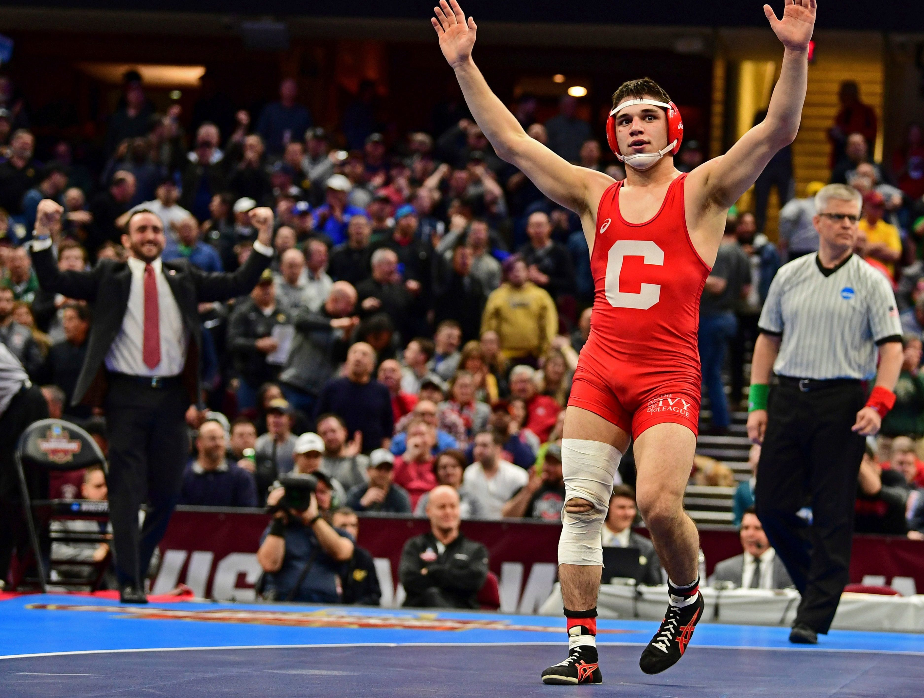 Cornell's Yanni Diakomihalis celebrates after defeating Wyoming's Bryce Meredith during the 141-pound championship match of the NCAA Division I Wrestling Championships, Saturday, March 17, 2018, in Cleveland. (AP Photo/David Dermer)