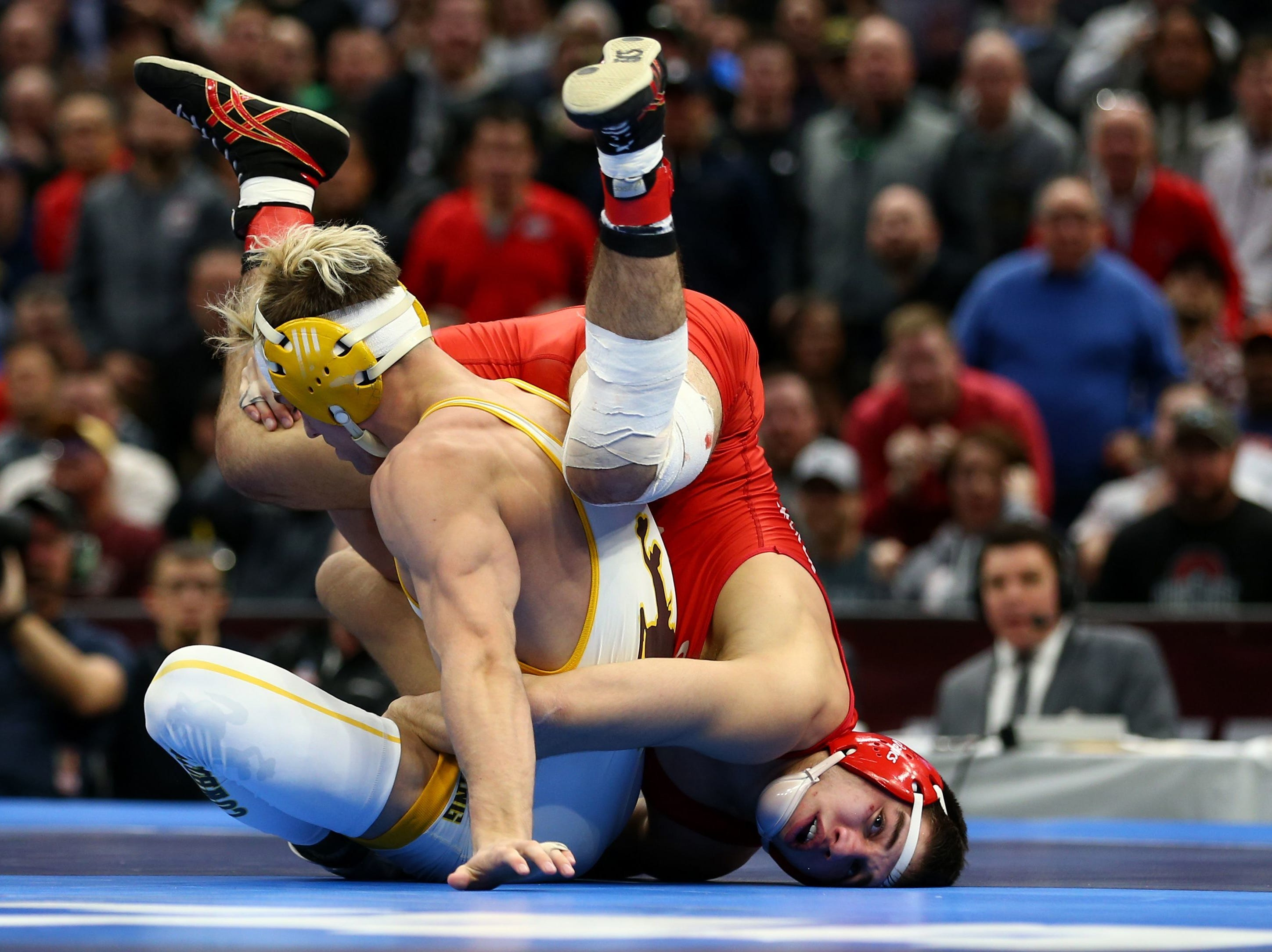 Wyoming  wrestler Meredith, white, competes against Cornell wrester Diakomihalis during the NCAA Wrestling DI Wrestling Championships at Quicken Loans Arena. Mar 17, 2018; Cleveland, OH, USA; Wyoming Cowboys wrestler Bryce Meredith (white) competes against Cornell wrester Yianni Diakomihalis (red) during the NCAA Wrestling DI Wrestling Championships at Quicken Loans Arena. Mandatory Credit: Aaron Doster-USA TODAY Sports
