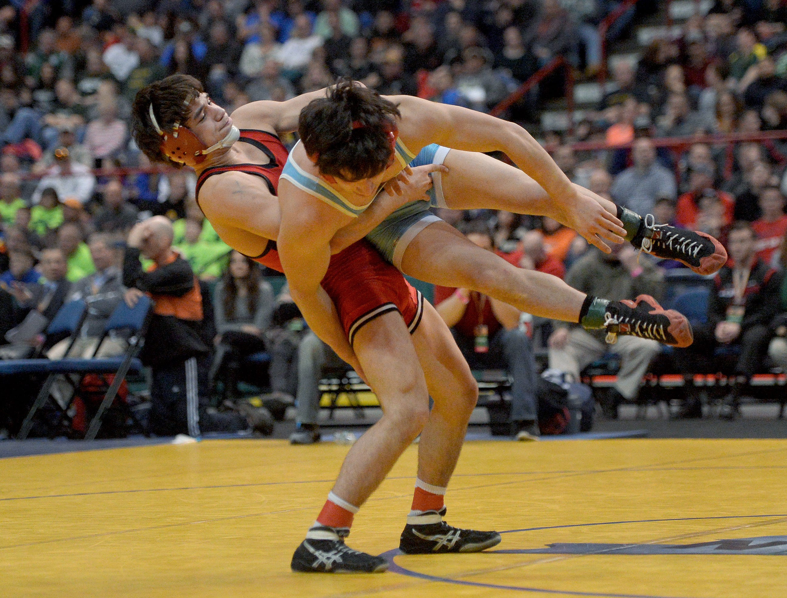 Hilton's Yianni Diakomihalis, left, wrestles against Fox Lane's Matthew Grippi-1 in the finals of the 138-pound class (Division I) during the NYSPHSAA 2016 State Wrestling Championships held at the Times Union Center in Albany, N.Y. on Saturday, Feb. 27, 2016.