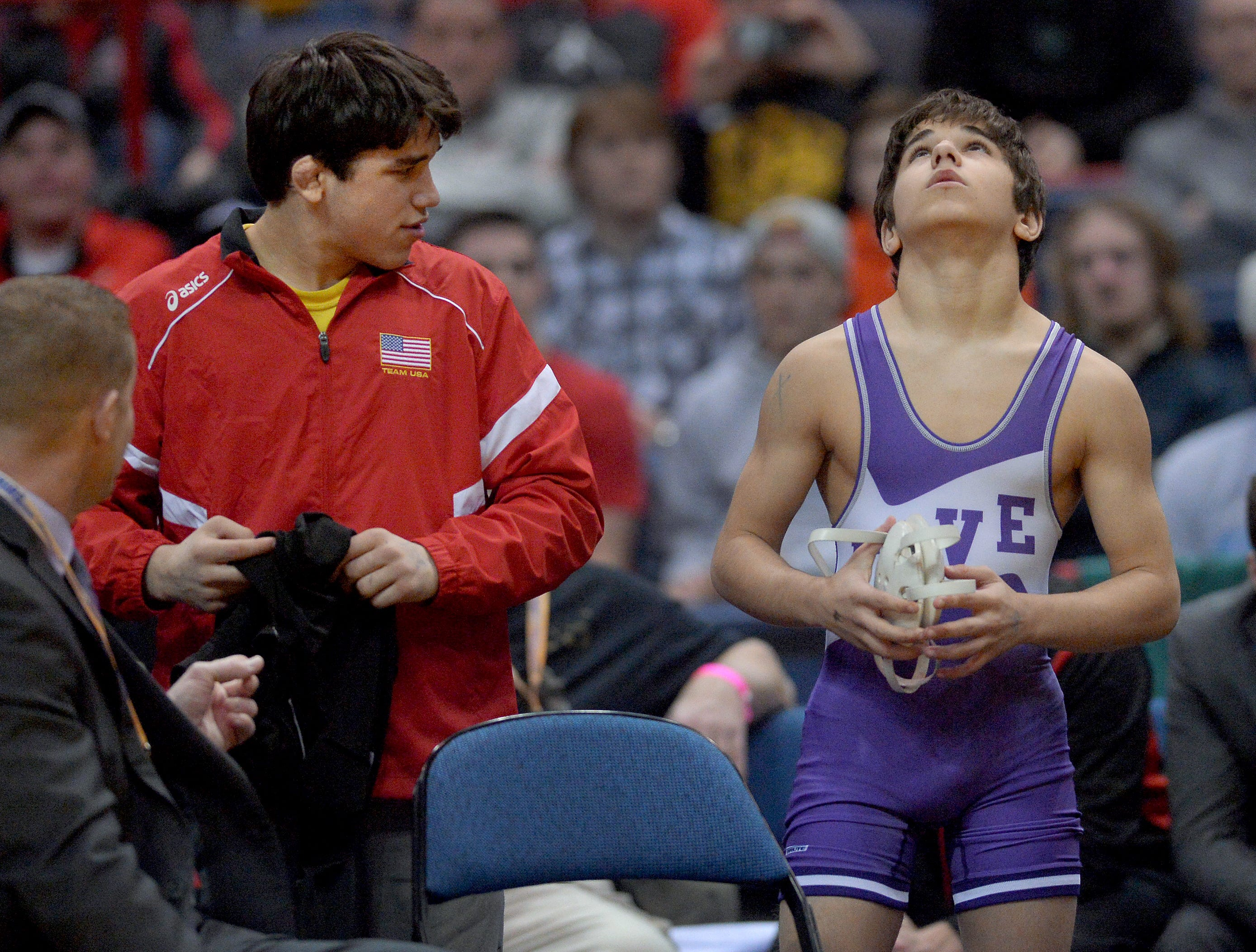 Hilton's Yianni Diakomihalis, left, talks to his brother Greg prior to his match in the finals of the 99-pound class (Division I) during the NYSPHSAA 2016 State Wrestling Championships held at the Times Union Center in Albany, N.Y. on Saturday, Feb. 27, 2016.
