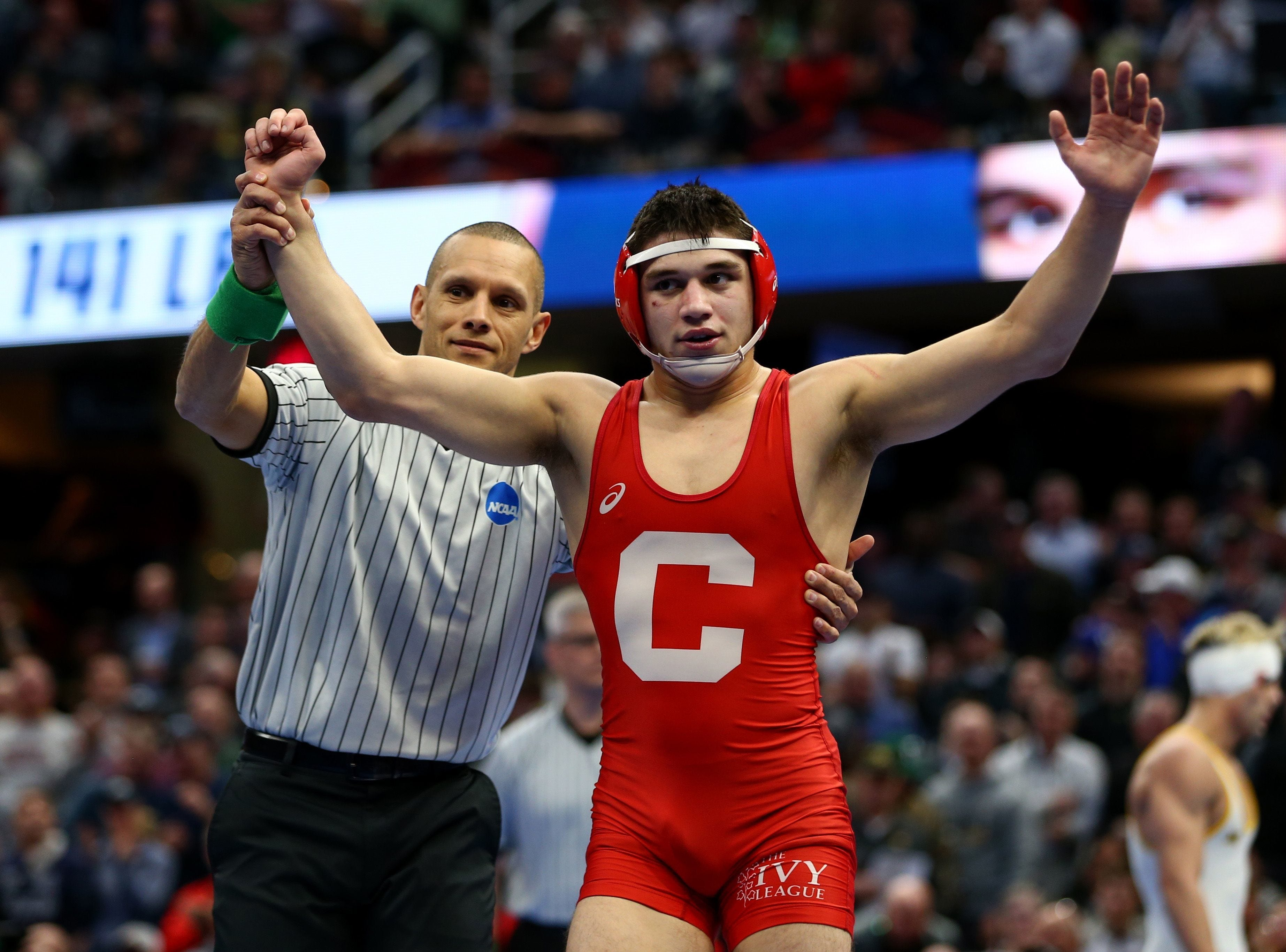 Mar 17, 2018; Cleveland, OH, USA; Cornell wrester Yianni Diakomihalis reacts after defeating Wyoming Cowboys wrestler Bryce Meredith during the NCAA Wrestling DI Wrestling Championships at Quicken Loans Arena.