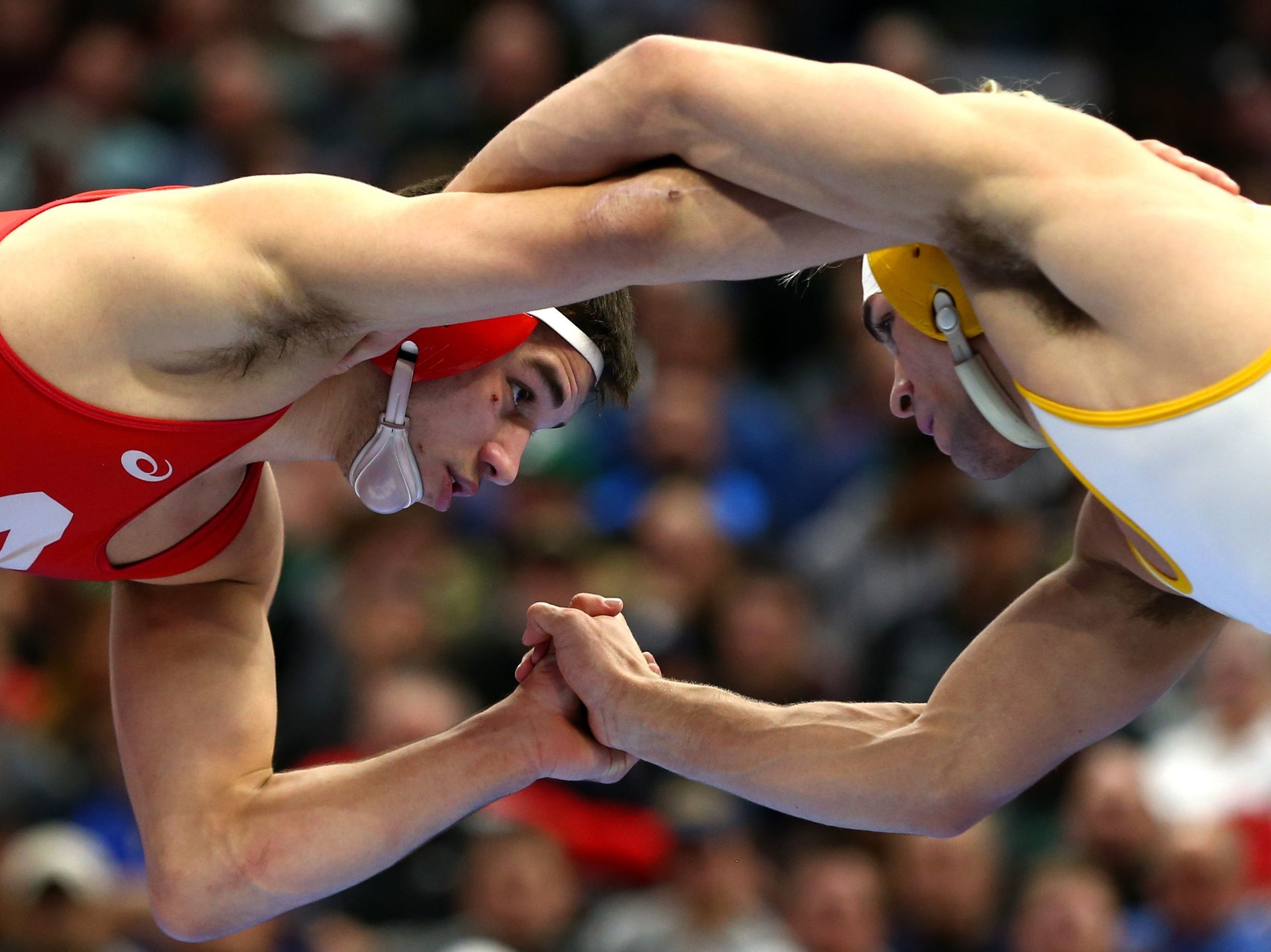 Wyoming  wrestler  Meredith, right, competes against Cornell wrester Diakomihalis  during the NCAA Wrestling DI Wrestling Championships at Quicken Loans Arena.  Aaron Doster/USA TODAY Sports Mar 17, 2018; Cleveland, OH, USA; Wyoming Cowboys wrestler Bryce Meredith (white) competes against Cornell wrester Yianni Diakomihalis (red) during the NCAA Wrestling DI Wrestling Championships at Quicken Loans Arena. Mandatory Credit: Aaron Doster-USA TODAY Sports