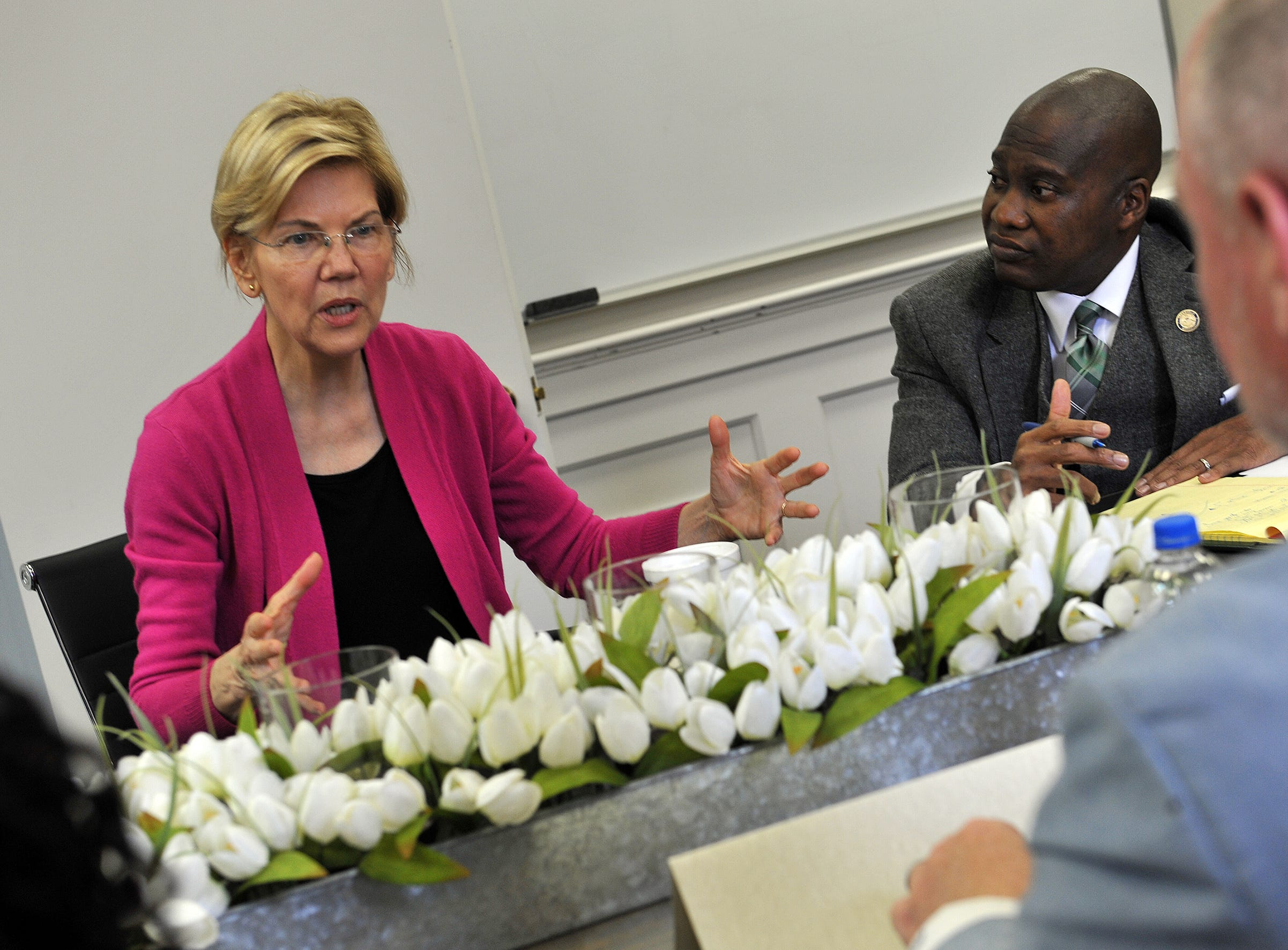 Presidential candidate Sen. Elizabeth Warren, D-Mass., from left, Mayor Erick Simmons, and Daniel Boggs, CEO of the Greater Greenville Housing & Revitalization Association, discuss the affordable housing shortage in the city during her visit to Greenville Monday, March 18, 2019. Greenville was a stop on Sen. Warren's a three-state Southern tour.