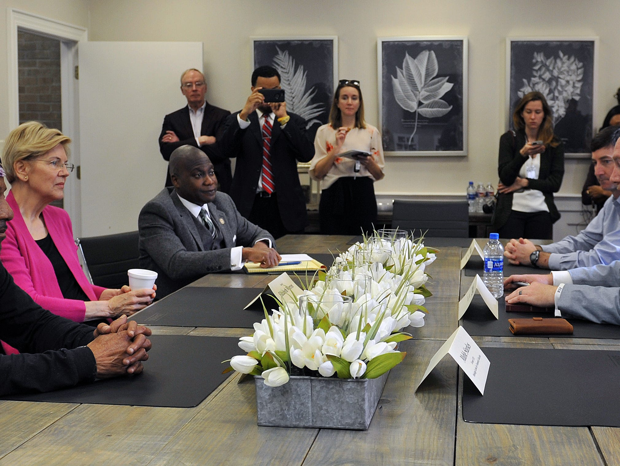 Presidential candidate Sen. Elizabeth Warren, D-Mass., second from left, discusses housing issues with Greenville Mayor Erick Simmons, local residents and housing experts, including Daniel Boggs, seated, second from right, CEO of the Greater Greenville Housing & Revitalization Association, Monday, March 18, 2019.