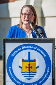 Mary Woodward, chancellor of the Diocese of Jackson, reads the 2019 list of clergy with credible allegations of sexual abuse of minors during a Tuesday, March 19, 2019, news conference outside the Cathedral of St. Peter The Apostle Catholic Church in Jackson. Victims, both boys and girls, range in ages 5-17 years old.