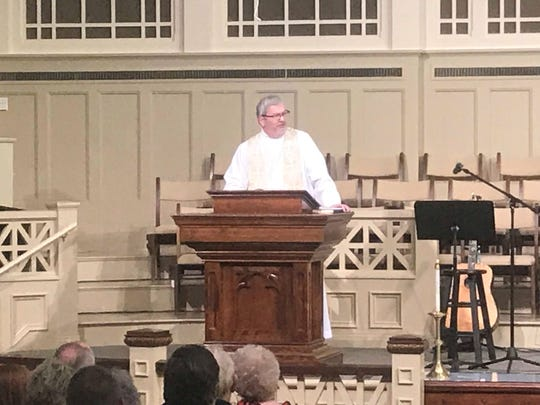 Sky McCracken, the pastor at First United Methodist Church, speaks at during a service.
