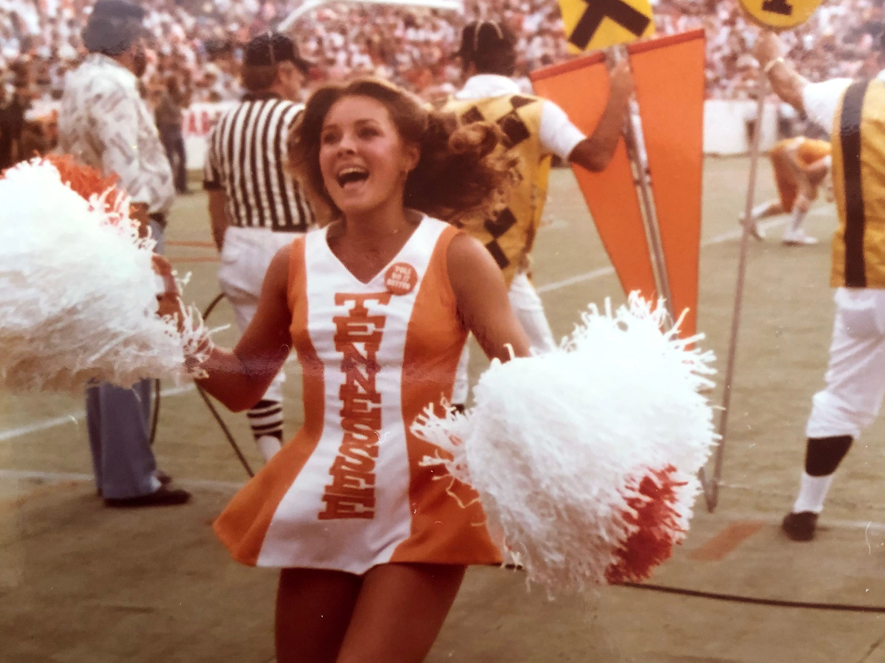 Angie Troutman cheers on the sidelines for the Vols football team. She was a member of the UT cheer team 1978-1980.