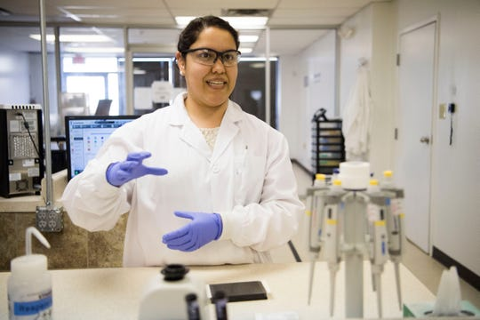 Selena Ledesma, lab tech at EDP Biotech, explains how she processes samples from the ColoPlex kits at EP Biotech's laboratory in Knoxville Tuesday, March 19, 2019.