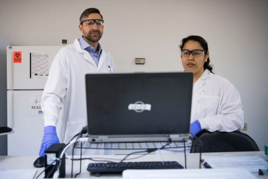 From left Jason Liggett, Ph.D., lead scientist at EDP Biotech, and Selena Ledesma, lab tech at EDP Biotech, explains how she processes samples from the ColoPlex kits at EP Biotech's laboratory in Knoxville Tuesday, March 19, 2019.
