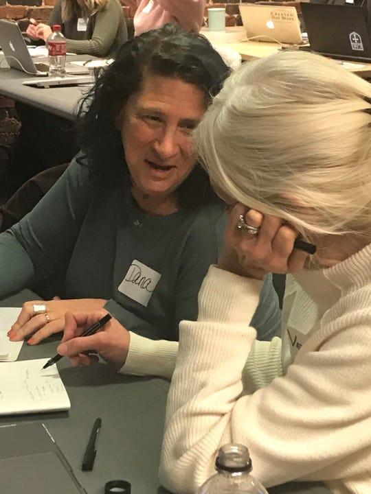 Dana McAlister, left, brainstorms with Victoria Hahn about identifying target customers at the Etsy Craft Entrepreneurship class on March 16.