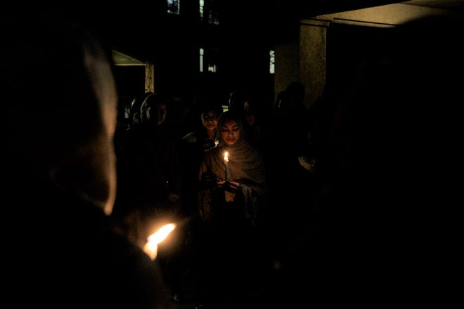 West Lafayette Jr./Sr. High sophomore Madeeha Sadiq stands in a moment of silence at the vigil for the victims of the mosque shooting in New Zealand. Sadiq spoke to a crowd of 200 attendee and asked they not become numb and complicit to hateful violence.