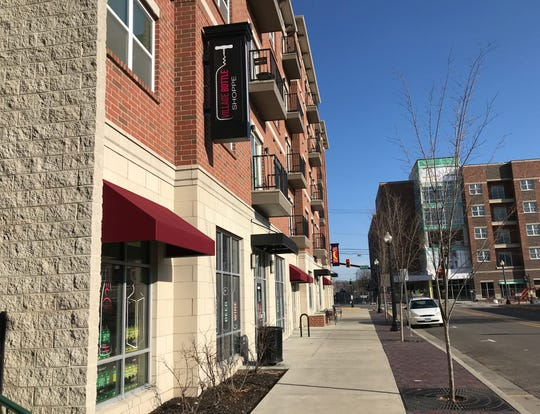 Village Bottle Shoppe, 225 Northwestern Ave., left, the closest liquor store to Purdue's campus, will close March 31, 2019, and reopen in the summer at Hi Vine, right, a 73-apartment, six-retail business going up a block away on Vine Street in West Lafayette.