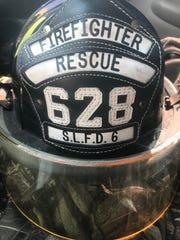 Connor Manuel's volunteer fire department hat.
