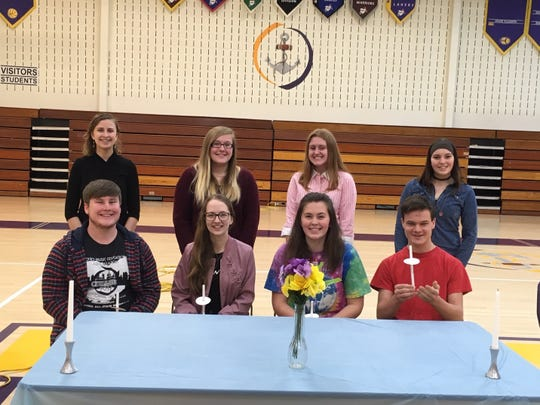 New members of the Walnut Township Chapter of the National Honor Society (seated left to right) Stephen Warner, Hailey Blanchard, Sydney Tisdale, and Andrew Warner; current members (standing left to right) Tiffany Atwood, Kyla Diley, Hannah Harrison and Hailey Waibel.