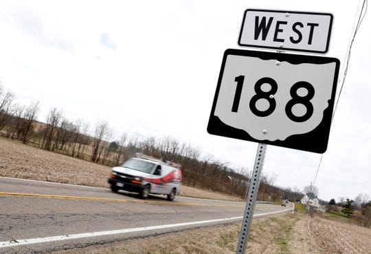 A van drives down a stretch of Ohio 188 Tuesday morning, March 19, 2019, in Hocking Township. The Ohio Department of Transportation plans to resurface the highway from U.S. 22 in Lancaster to the Pickaway County line.