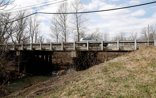 A minivan drives over a bridge on Ohio 664 Tuesday morning, March 19, 2019, south of Bremen. The Ohio Department of Transportation is planning to replace the bridge's deck this year.