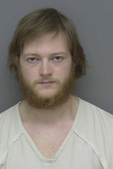 Clifford Fouts, 23, is charged with numerous felonies in connection with possession of child pornography.